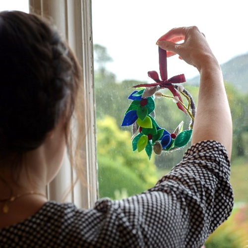 A homemade craft being looked at by a window